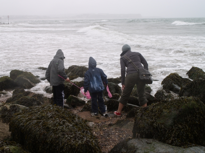 Welcome to Devon and the Bleakest Beach in the World!  Crabbing in the rain on the beach with V's nephews